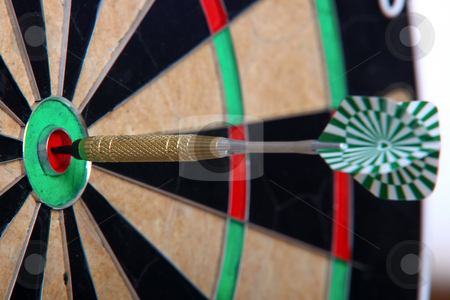 Arrow Stiffed In The Center stock photo, Arrow Stiffed Right In The Middle Of Darts Board by Nick Fingerhut