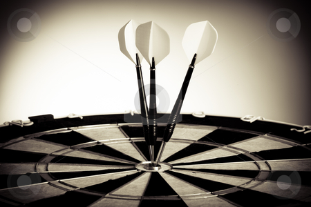 Perspective Photo Of Three Arrows On Darts Table stock photo, Perspective Photo Of Three Arrows Hitting The Center Of Darts Table by Nick Fingerhut