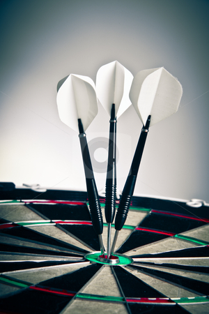 Darts Arrows Right In The Center stock photo, Three Darts Arrows Poked Right In The Center by Nick Fingerhut