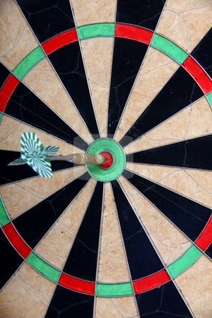Straight To The Target stock photo, Straight To The Target Arrow On Darts Board by Nick Fingerhut