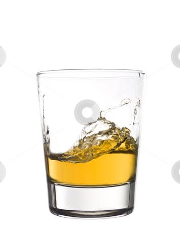 Whisky splash stock photo, Whisky splash by Anne-Louise Quarfoth