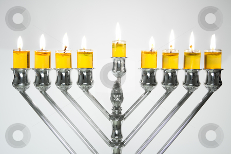 Hanukkah Menorah / Hanukkah Candles stock photo, Silver Hanukkah candles with oil candles, all candles lite on the traditional Hanukkah menorah by Dmitry Pistrov