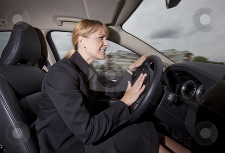 Woman in the car stock photo, Woman in the car by Anne-Louise Quarfoth