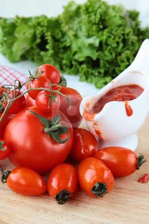Tomato of different varieties and sauce  stock photo, Tomato of different varieties and sauce in a gravy boat by Olga Kriger