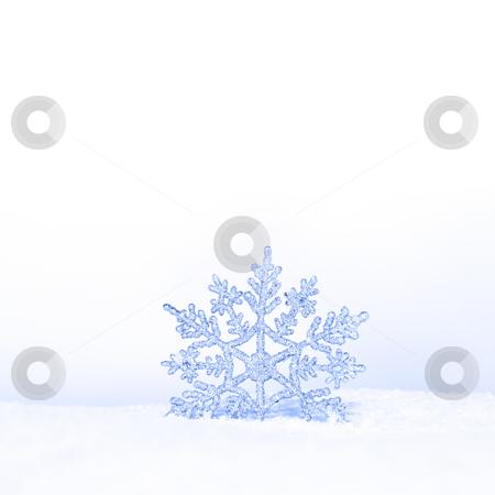 Beautiful snowflake stock photo, Beautiful silver snowflake in snow by Viktor Thaut