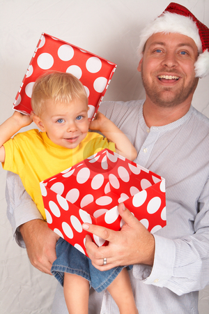 Baby boy with his father for Christmas stock photo, Baby boy with his father for Christmas holding a large gift box by Elena Weber (nee Talberg)