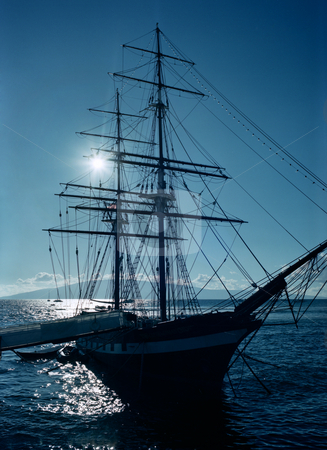 Sail ship stock photo, Sail ship at dock back lit by sun by Christian Delbert