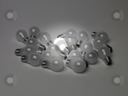 Pile of light bulbs stock photo, Pile of light bulbs by Anne-Louise Quarfoth
