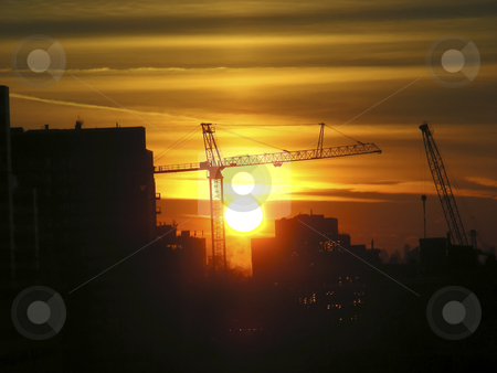 Setting Sun stock photo, A bright orange setting sun, against an urban landscape by Mary Lane
