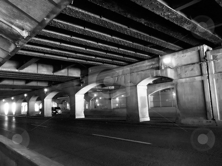 Road Grit stock photo, Black and white and grainy - to show urban grit - a roadway underpass in Toronto. by Mary Lane