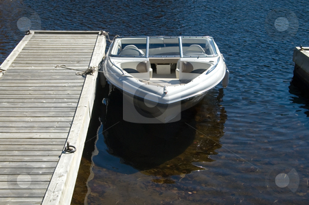 At the Dock stock photo, Nice little power boat tied up at a lakeside dock. by Mary Lane
