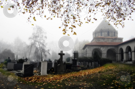 Foggy Churchyard stock photo, A foggy churchyard and graveyard, in southern Germany. by Mary Lane