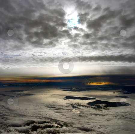 Island in the Clouds stock photo, Weird and wild skyscape with islands poking off the clouds, off the coast of Vancouver, Canada. by Mary Lane