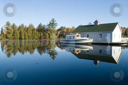 Cottage Country stock photo, Smooth clear lake and fall colors - great cottage country. by Mary Lane