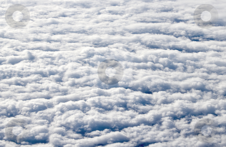 Flying high above white clouds. stock photo, Flying high above white clouds. by Stephen Rees