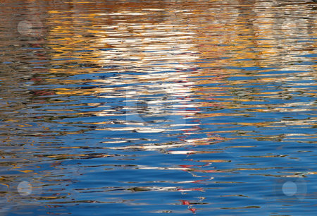 Colourful water ripples reflections. stock photo, Colourful water ripples reflections. by Stephen Rees