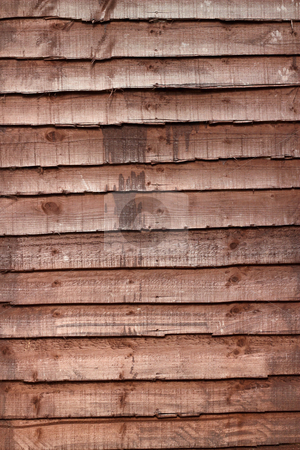 Brown panels in a wooden fence.  stock photo, Brown panels in a wooden fence. by Stephen Rees