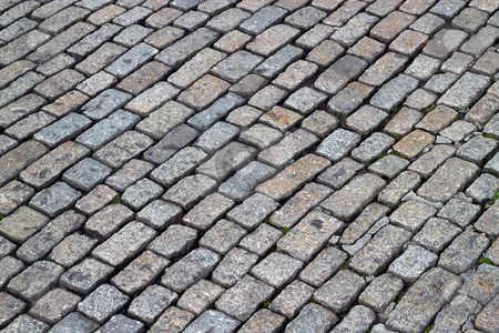 Old English cobblestones road close up. stock photo, Old English cobblestones road close up. by Stephen Rees