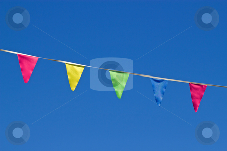 Small colorful flags and a blue sky. stock photo, Small colorful flags and a blue sky. by Stephen Rees