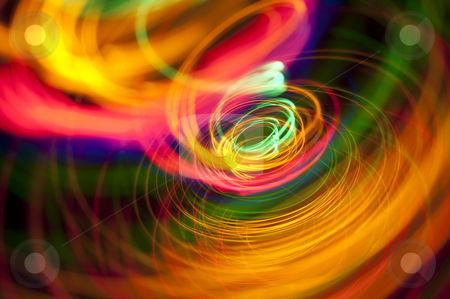 Abstract light spiral stock photo, A swirl of vivid coloured trails of light by Stephen Gibson