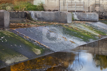 Old river dam stock photo, Old diversion dam with irrigation ditch inlet - Cache la Poudre River in Fort Collins, Colorado, fall scenery with low water by Marek Uliasz