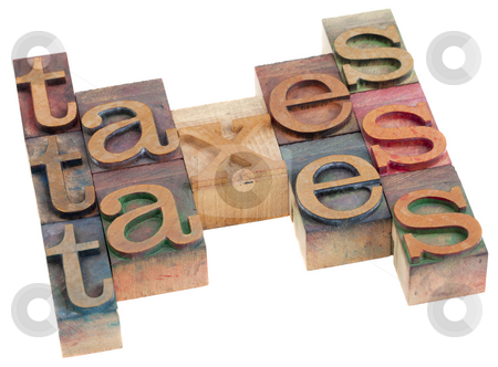 Taxes word abstract stock photo, Taxes word abstract in vintage wooden letterpress priting blocks isolated on white by Marek Uliasz