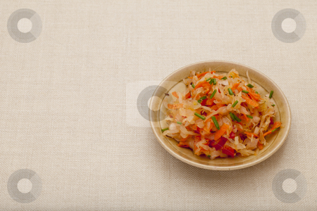 Sauerkraut salad stock photo, A side dish of sauerkraut salad with carrot, pepper, chives and caraway - a small ceramic bowl against tablecloth by Marek Uliasz