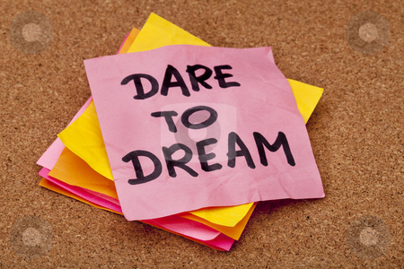 Dare to dream stock photo, Dare to dream, motivational slogan, colorful sticky notes on cork bulletin board by Marek Uliasz