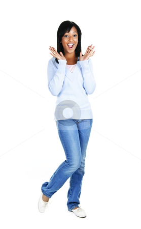 Excited young woman stock photo, Excited surprised black woman standing isolated on white background by Elena Elisseeva