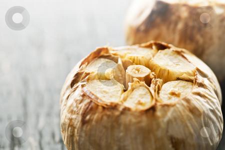 Roasted garlic bulbs stock photo, Close up of fresh roasted garlic bulbs by Elena Elisseeva