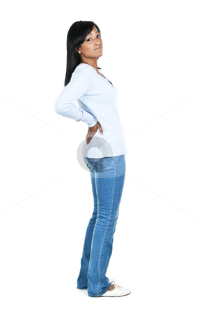 Woman with back pain stock photo, Black woman with back pain standing isolated on white background by Elena Elisseeva