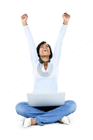 Successful young woman with computer stock photo, Excited black woman with arms raised and computer isolated on white background by Elena Elisseeva