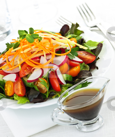 Garden salad stock photo, Plate of healthy green garden salad with fresh vegetables served with balsamic dressing by Elena Elisseeva