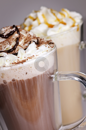 Hot chocolate and coffee beverages stock photo, Hot chocolate and coffee latte beverages with whipped cream by Elena Elisseeva