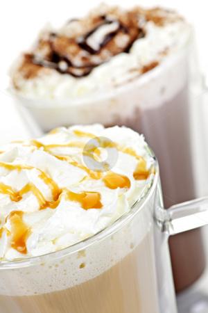 Hot chocolate and coffee beverages stock photo, Hot chocolate and coffee latte beverages with whipped cream by Elena Elisseeva