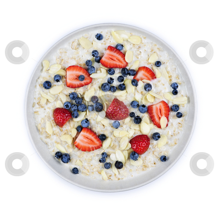 Bowl of oatmeal with berries stock photo, Bowl of hot oatmeal breakfast cereal with fresh berries from above by Elena Elisseeva