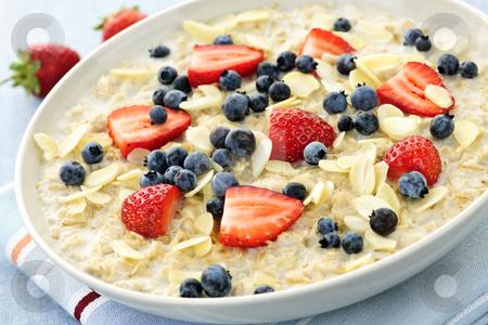 Oatmeal breakfast cereal with berries stock photo, Bowl of hot oatmeal breakfast cereal with fresh berries by Elena Elisseeva