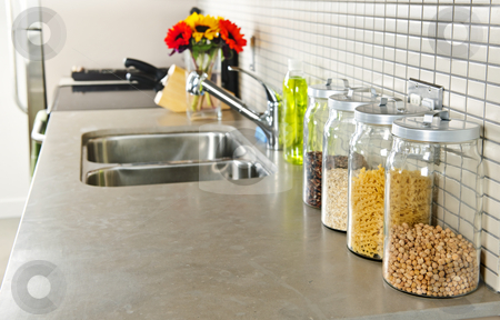 Kitchen interior stock photo, Modern small kitchen interior with glass jars on natural stone countertop by Elena Elisseeva