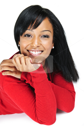 Portrait of young black woman smiling stock photo, Portrait of black woman smiling laying isolated on white background by Elena Elisseeva