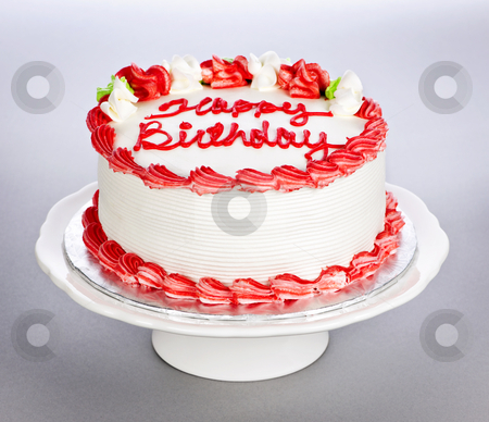 Birthday cake stock photo, Birthday cake with white and red icing on plate by Elena Elisseeva
