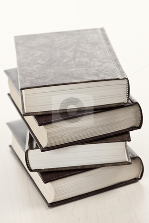 Stack of books stock photo, Stack of old hard cover leather bound books by Elena Elisseeva