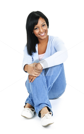 Relaxing young woman stock photo, Relaxing black woman sitting on floor isolated on white background by Elena Elisseeva