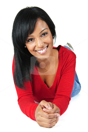 Young woman smiling laying down stock photo, Portrait of black woman smiling laying isolated on white background by Elena Elisseeva