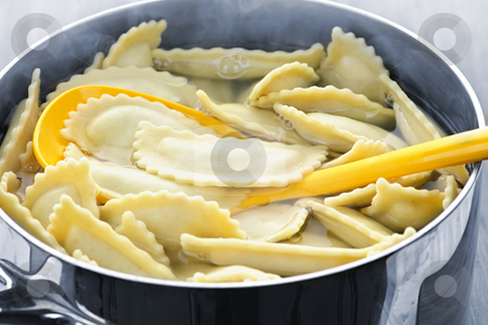 Cooking ravioli stock photo, Cooking and stirring pot of ravioli pasta in boiling water by Elena Elisseeva