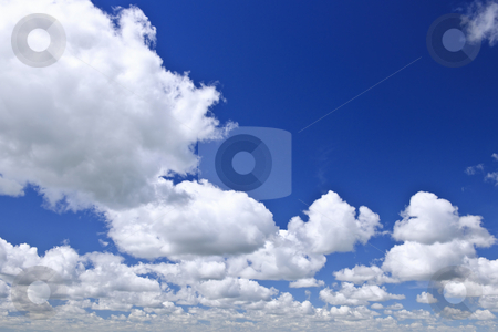 Blue sky with white clouds stock photo, Background of blue sky with white cumulus clouds by Elena Elisseeva