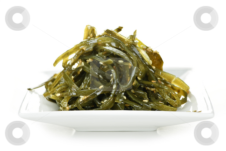 Seaweed salad stock photo, Plate of wakame seaweed salad on white background by Elena Elisseeva