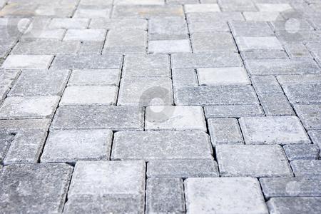 Interlocking stone driveway stock photo, Gray interlocking paving stone driveway from above by Elena Elisseeva