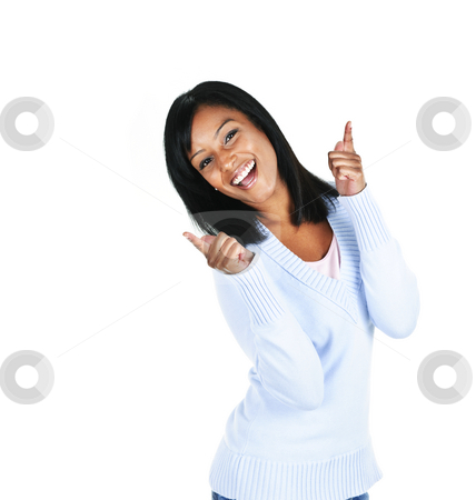 Smiling young woman stock photo, Smiling black woman pointing up isolated on white background by Elena Elisseeva