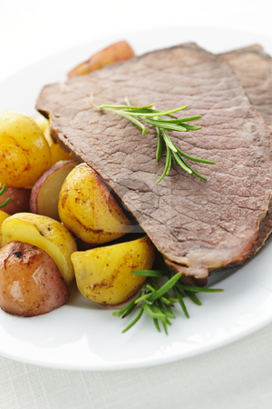 Roast beef and potatoes stock photo, Serving of roast beef and roasted potatoes meal by Elena Elisseeva