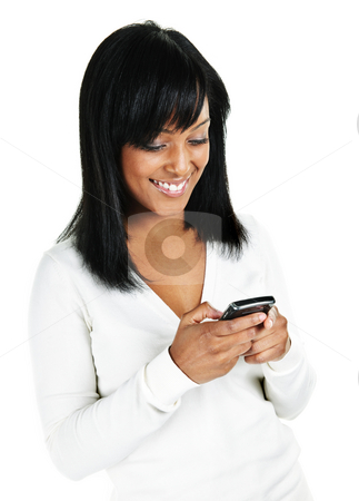 Young woman texting stock photo, Smiling black woman texting on cell phone portrait isolated on white background by Elena Elisseeva